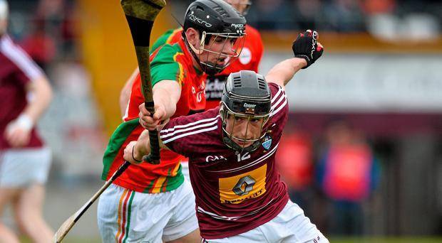 Westmeath's Eoin Price tries to get away from Carlow's Sean Murphy during their Leinster SHC qualifier clash in Cusack Park