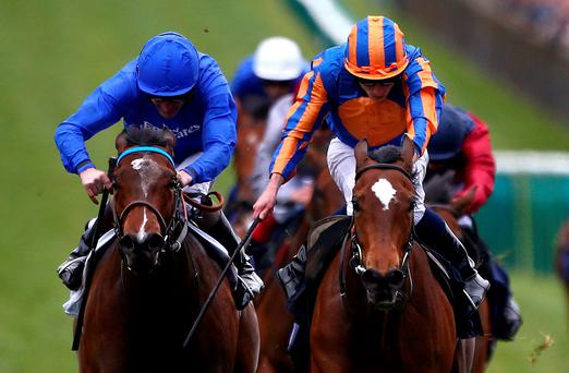 Ryan Moore drives Legatissimo (right) to victory from Lucida (Kevin Manning) in the 1,000 Guineas at Newmarket yesterday