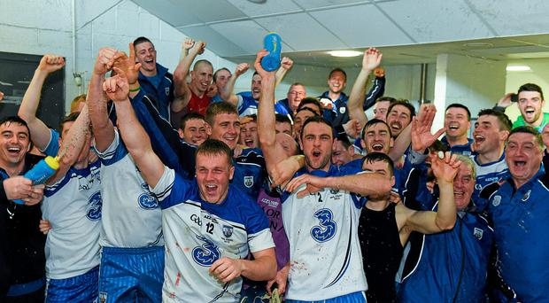 Waterford players celebrate in the dressing rooms at Semple Stadium after their Allianz NHL final victory over Cork