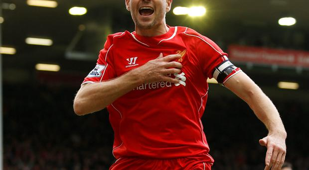 Liverpool's Steven Gerrard celebrates scoring his side's winning goal against QPR at Anfield on Saturday