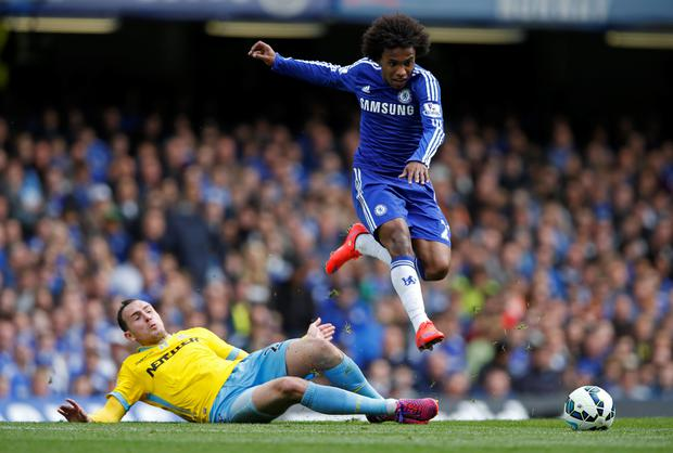 Crystal Palace's Jordon Mutch in action with Chelsea's Willian