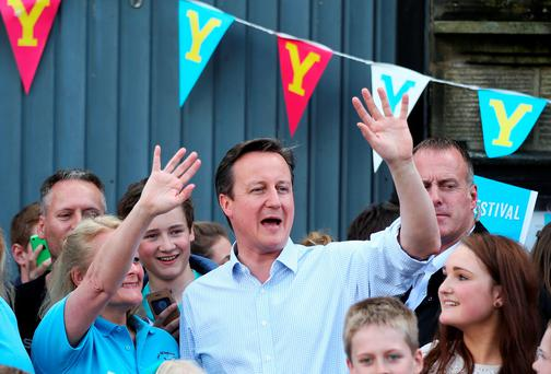 Polls have prime minister David Cameron's Conservatives roughly level with the Labour Party led by Ed Miliband, suggesting a coalition government is the most likely outcome (Lynne Cameron/PA Wire)