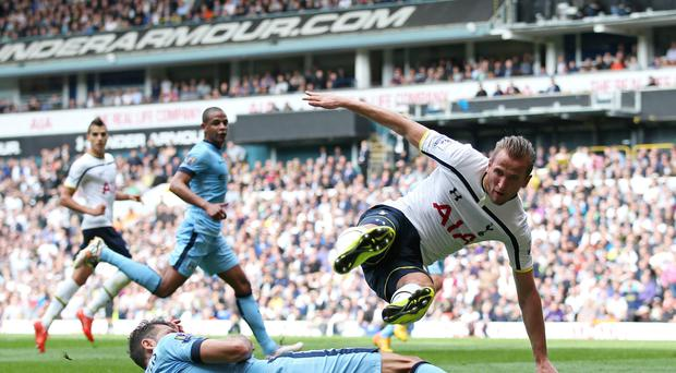 Martin Demichelis of Manchester City tackles Tottenham's Harry Kane yesterday