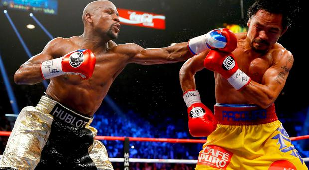 Floyd Mayweather lands a left hand on Manny Pacquiao during his comfortable victory in Las Vegas