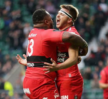 Drew Mitchell celebrates with Mathieu Bastareaud after scoring Toulon's second try at Twickenham