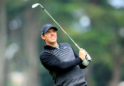World No 1 Rory McIlroy snatched a semi-final victory over Jim Furyk in true champion style at the WGC-Cadillac Match Play Championship