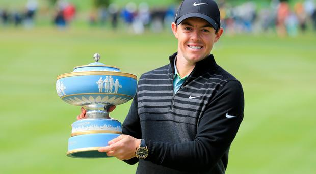 Rory McIlroy of Northern Ireland lifts the Walter Hagen Cup after defeating Gary Woodland 4&2 in the championship match of the World Golf Championships Cadillac Match Play at TPC Harding Park, San Francisco, California