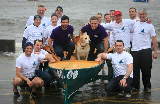 Crew members from Row-A-Round Ireland – including Joey the dog, who will be taking part – pictured with All-Ireland winning Dublin footballer Cian O'Sullivan and Leinster and Ireland rugby star Ian Madigan at Bray Harbour in Co Wicklow.