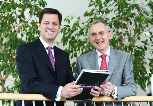 Tony Smurfit, left, who recently succeeded former CEO Gary McGann, right, pictured at Smurfit Kappa AGM
