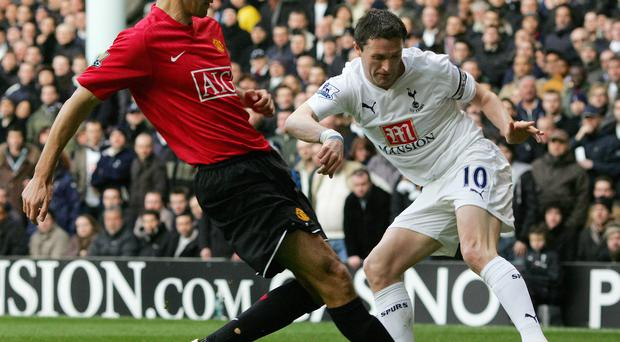Robbie Keane in action against Rio Ferdinand during his time at Tottenham