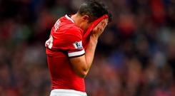 Robin van Persie of Manchester United reacts after missing a penalty during the Barclays Premier League match between Manchester United and West Bromwich Albion at Old Trafford
