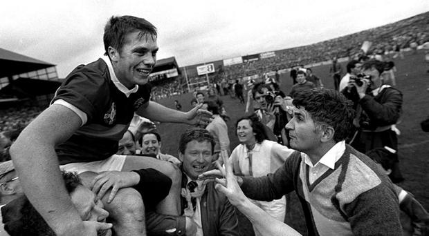 Kerry captain Paidi O'Se is held aloft alongside manager Mick O'Dwyer, right, after victory over Dublin in the 1985 All-Ireland final