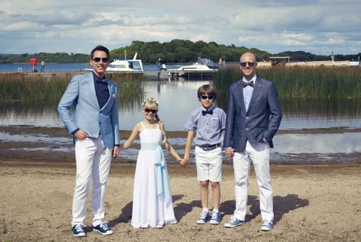 George Clarke with his husband Kenny, daughter Tobyn and son Leo pictured at their wedding at Knockninny Country House and Marina last summer Pic: Belfast Telegraph