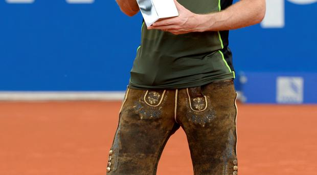 Andy Murray, dressed in a 'Lederhose', Bavarian leather trousers, poses with the trophy during the award ceremony after his final match against Germany's Philipp Kohlschreiber during the ATP Tennis BMW Open in Munich. Murray won the match 7-6, 5-7 and 7-6.