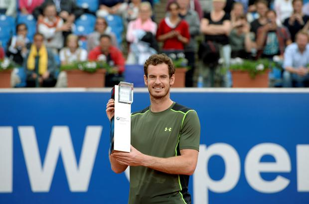 Andy Murray poses with the trophy during the award ceremony after his final match against Germany's Philipp Kohlschreiber during the ATP Tennis BMW Open in Munich, southern Germany, on May 4, 2015. Murray won the match 7-6, 5-7 and 7-6.