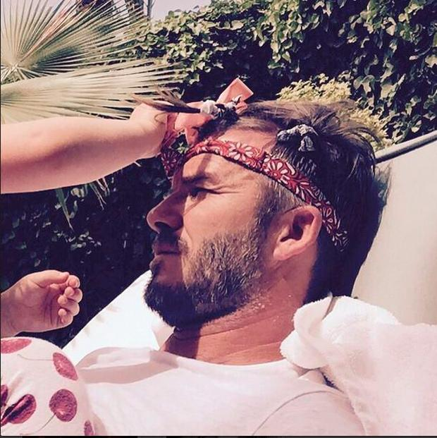 Harper trying to make her father David Beckham 'feel pretty' after a 'heavy night' Pic: Daivd Beckham/Instagram