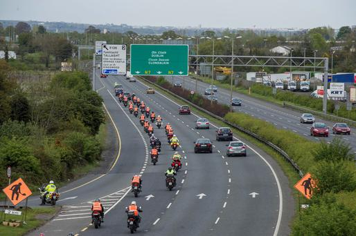 The funeral cortege for Aidan Lynam arriving in Dublin at Brown's Brown.