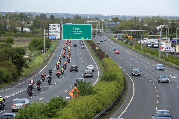 Monday 04 May 2015. The funeral cortege for Aidan Lynam arriving in Dublin at Brown's Brown.