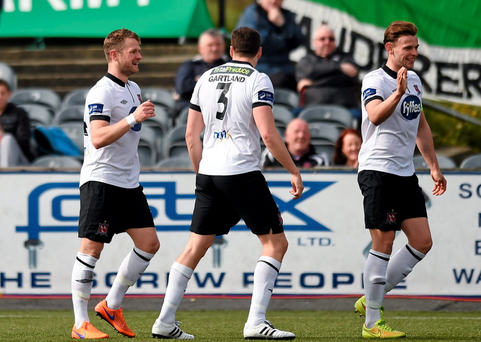 Dane Massey, left, Dundalk, celebrates after scoring his side's 6th goal with team-mates Brian Gartland and Andy Boyle, right
