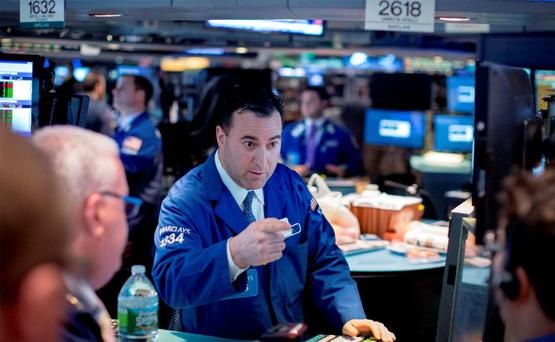 Traders work on the floor of the New York Stock Exchange. Photo: Reuters