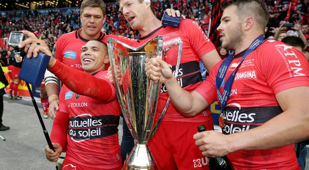 Toulon's Bryan Habana poses with Juanne Smith, Bakkies Botha and team mates as he takes a selfie while they celebrate winning the European Rugby Champions Cup Final with the trophy (Action Images via Reuters / Henry Browne)