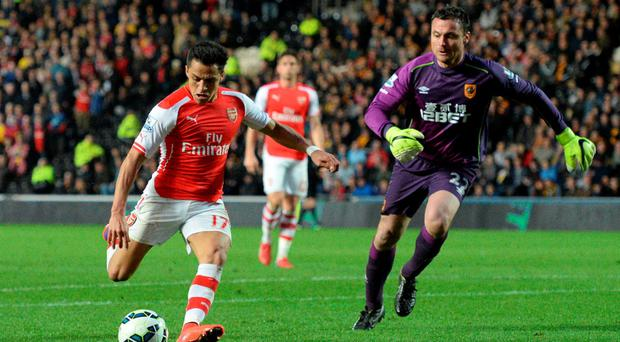 Hull City's goalkeeper Steve Harper watches as Arsenal striker Alexis Sanchez scores his second goal at the KC Stadium