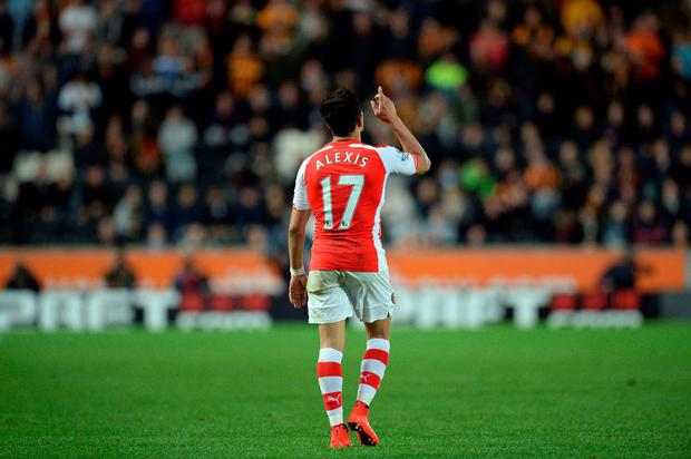 Alexis Sanchez celebrates scoring his second goal against Hull City at the KC Stadium