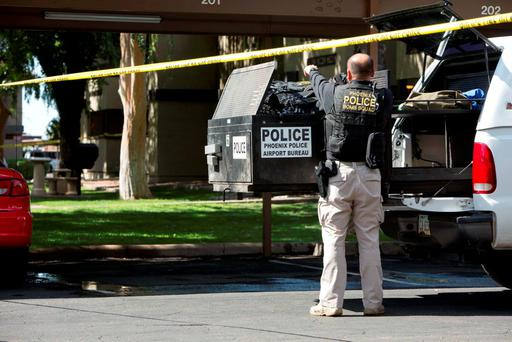 Police work inside a cordoned off area at the Autumn Ridge apartment complex which had been searched by investigators in Phoenix, Arizona. Photo: Reuters