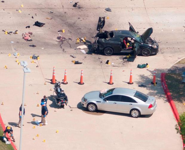 An aerial view shows the area around a car that was used the previous night by two gunmen, who were killed by police, as it is investigated by local police and the FBI in Garland, Texas. Photo: Reuters