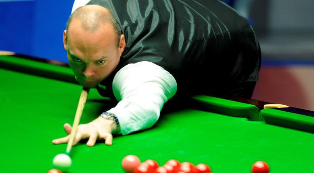 Stuart Bingham at the table in the final match against Shaun Murphy during day seventeen of the Betfred World Championships at the Crucible Theatre, Sheffield.