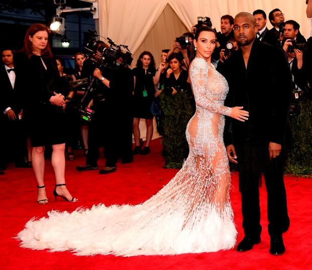 Kim Kardashian West (L) and Kanye West attend the
