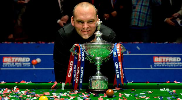 Stuart Bingham celebrates with the trophy after winning the final of the Betfred World Championships at the Crucible Theatre