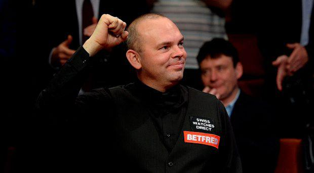 Stuart Bingham celebrates after winning the final of the Betfred World Championships at the Crucible Theatre, Sheffield