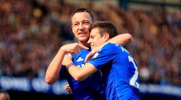 Chelsea's John Terry (left) and Cesar Azpilicueta celebrate after the Barclays Premier League match at Stamford Bridge, London