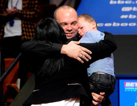Stuart Bingham celebrates with his wife Michelle and son after winning the final of the Betfred World Championships at the Crucible