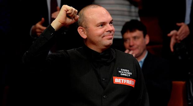 Stuart Bingham celebrates after winning the final of the Betfred World Championships at the Crucible