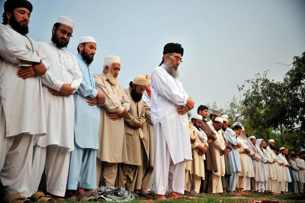 Pakistani residents offer funeral prayers in Peshawar for the attackers who were killed when they attempted to storm an anti-Muslim cartoon exhibition in Texas Credit: HASHAM AHMED