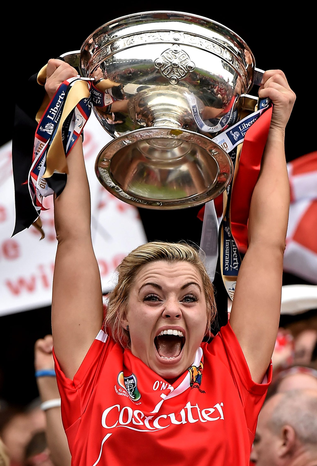 Cork captain Anna Geary lifts the O'Duffy Cup last September. She has announced her retirement aged 27.