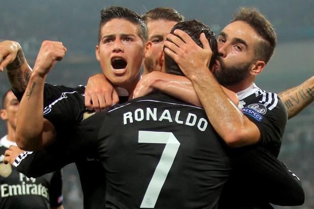 Real Madrid's Cristiano Ronaldo celebrates with teammates after his first-half goal at the Juventus stadium in Turin.