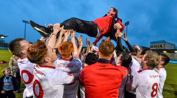 Tyrone U-21 manager Feargal Logan celebrates with his players after their All-Ireland final victory over Tipperary. Logan has robustly rejected Tipperary claims regarding 'sledging' and cynical tactics in the game