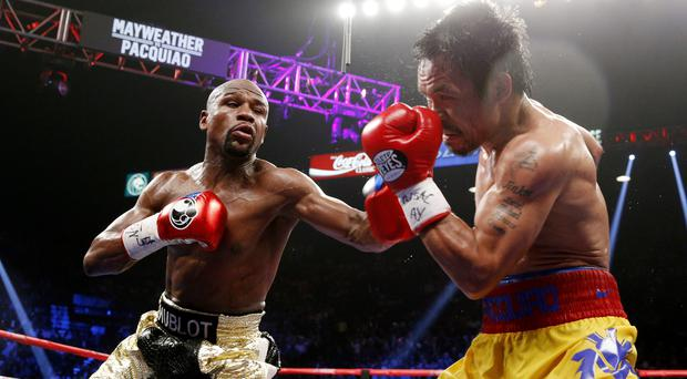 Floyd Mayweather exchanges punches with Manny Pacquiao during their welterweight bout in Las Vegas last weekend