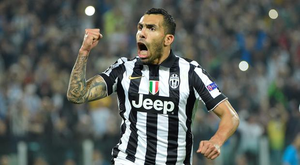 Juventus' forward from Argentina Carlos Tevez celebrates after scoring a penalty kick during the UEFA Champions League semi-final first leg football match Juventus vs Real Madrid (Getty Images)