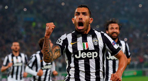 Carlos Tevez of Juventus celebrates as he scores their second goal from a penalty during the UEFA Champions League semi final first leg match between Juventus and Real Madrid