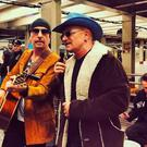 Bono and The Edge perform at Grand Central Station in New York