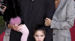 HOLLYWOOD, : Bruce Jenner (C), his wife Kris (R) and children Kylie (L) and Kendall (BELOW) appear at the, 10 December 2000, premiere of Walt Disney's