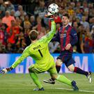 Lionel Messi beats Manuel Neuer to score Barcelona's second goal in the Champions League semi-final first leg at the Nou Camp last night