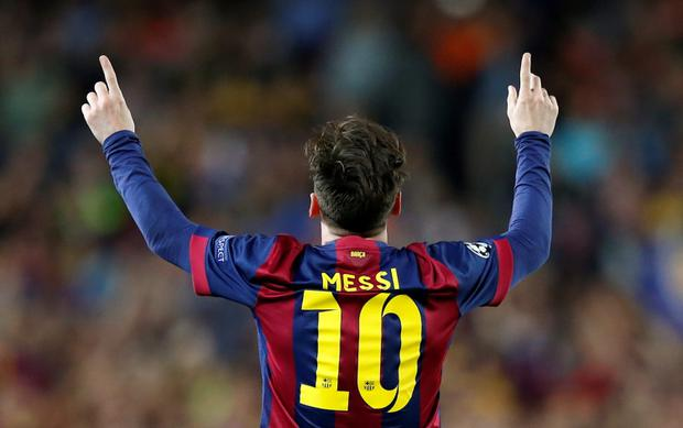 Barcelona's Lionel Messi celebrates scoring their first goal