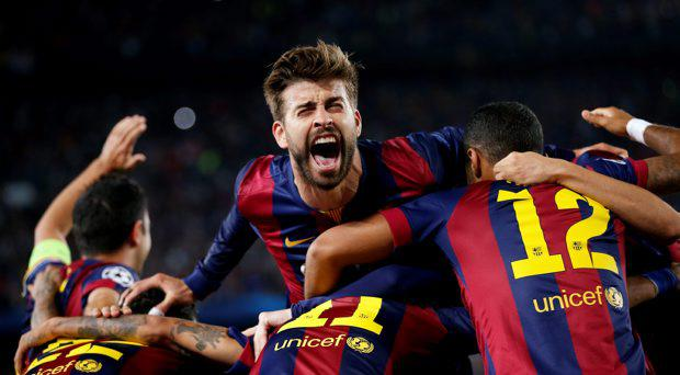 Barcelona's Gerard Pique celebrates after Neymar scores their third goal