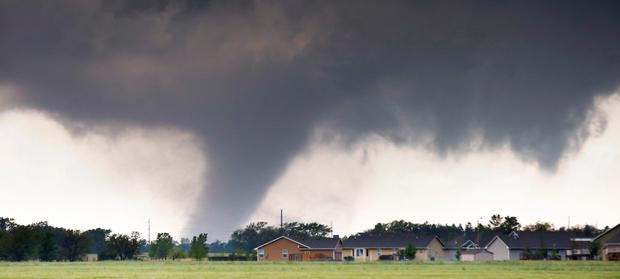A tornado passes near Halstead, Kansas (Travis Heying/The Wichita Eagle via AP)