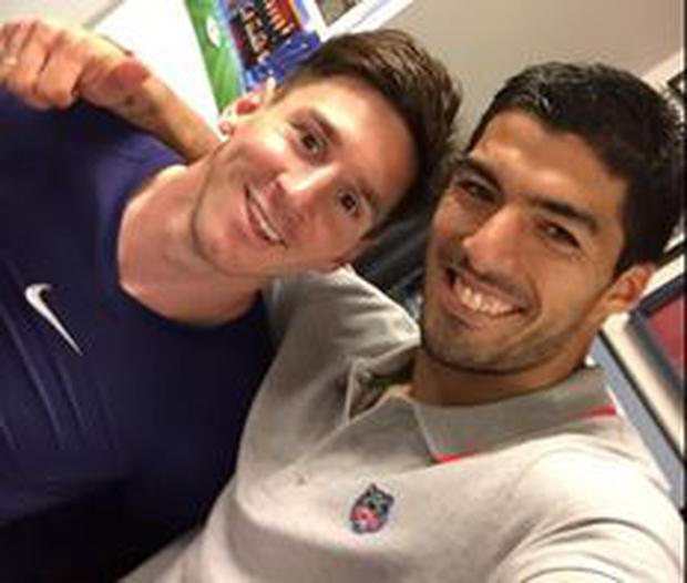 Leo Messi and Luis Suarez celebrate the 3-0 Champions League victory over Bayern Munich
